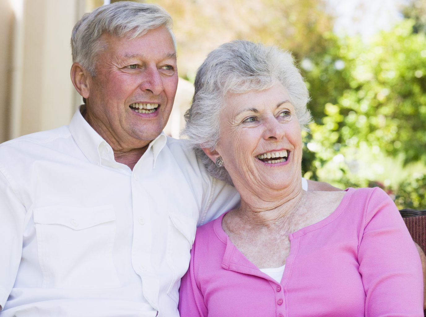 An older couple laughing together at Christian Village Communities